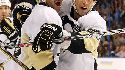 Penguins forward Craig Adams, right, congratulates teammate Pascal Dupuis on his first-period goal.