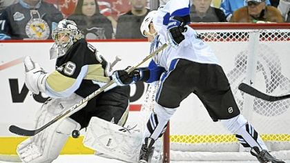 Marc-Andre Fleury makes a save against the Lightning's Adam Hall in the third period Friday.