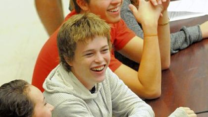 Cameron Clark, a senior at Schenley High School shares a laugh with his classmates at the school's cafeteria.