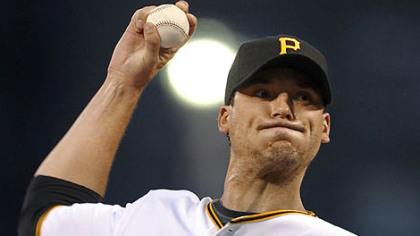Pirates starting pitcher Charlie Morton throws in the first inning.