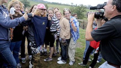 Students from the Western Pennsylvania School for the Deaf get their photo taken with Ashley Fiolek, 19, a motocross athlete who was born deaf. They visited the X Games gold medalist at the Steel City Raceway in Export.