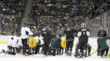 Penguins coach Dan Bylsma, right, talks to the team on ice during their first practice at the Consol Energy Center.