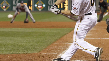 The Pirates' Brandon Moss gets an infield hit with the bases loaded to drive in run in the ninth inning.