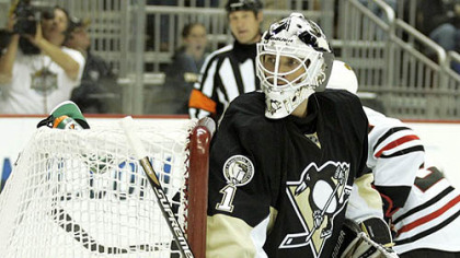 Penguins goaltender Brent Johnson eyes the puck in the corner during Tuesday's game against the Blackhawks at Consol Energy Center.