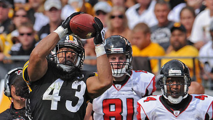 Steelers safety Troy Polamalu intercepts pass against the Falcons in the fourth quarter at Heinz Field during Sunday's game.