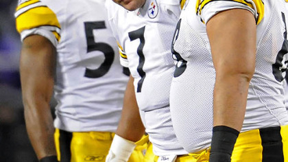 Steelers quarterback Ben  Roethlisberger is helped off the field after his nose was broken from a punch by the Ravens' Haloti Ngata in Sunday night's game. Ngata was fined $15,000 for the play.