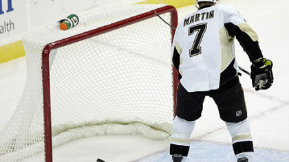Penguins defenseman Paul Martin scores an empty-net goal during the the third period.