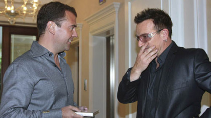 Russian President Dmitry Medvedev, left, and U2's Bono hang out.