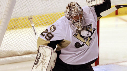 Penguins goalie Marc-Andre Fleury blocks a shot in the first period.