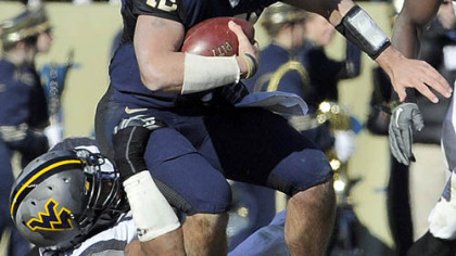 Pitt quarterback Tino Sunseri is sacked by WVU's Julian Miller.