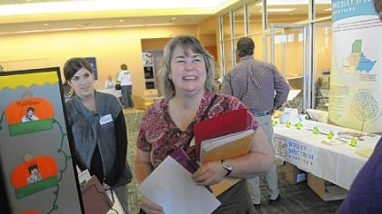 Sandra Wilson, center, of Rochester, a member of Northway Christian Church in Pine, talks during the Orphan Care Expo with Courtney Rademacher, left, and Russ McCurdy (barely visible), both of Project Star at the Children's Institute.