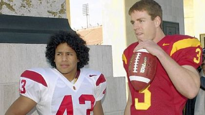 Polamalu's hair was shorter in college at Southern California, where he was teammate and roommate to Carson Palmer, now quarterback for the Cincinnati Bengals.