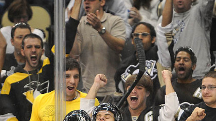 Penguins forward Tyler Kennedy celebrates with Mark Letestu scoring the first Penguins goal in the new Consol Energy Center in the third period.
