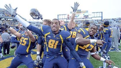 West Virginia's Tyler Rader, J.D. Wood and Ryan Clarke celebrate after beating Rutgers, 35-14, Saturday in Morgantown, W.Va.