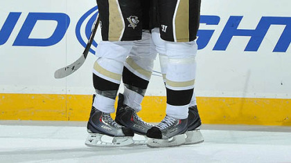 Penguins defenseman Alex Goligoski, left, is congratulated by forward Evgeni Malkin after scoring a goal during the first period.
