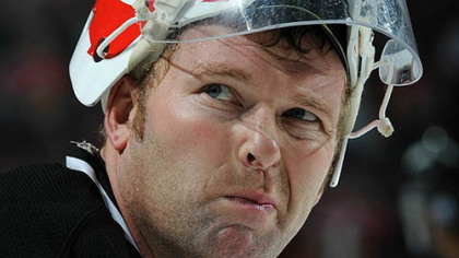 Devils goaltender Martin Brodeur lays on the ice after making a glove save during the third period.