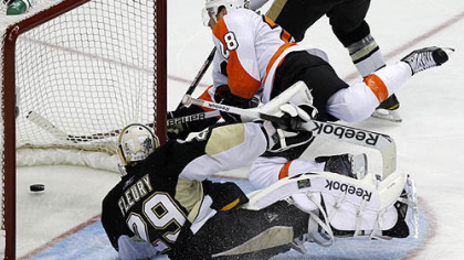 Flyers forward Claude Giroux gets a third period goal by Penguins goaltender Marc-Andre Fleury in the third period.