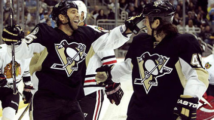 Penguins forward Max Talbot, left, celebrates a goal with teammate Arron Asham.