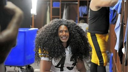 Troy Polamalu in the shampoo ad: The hair is a wig, but the smile is real.