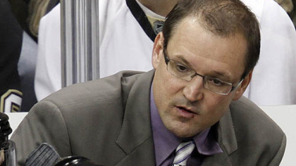 Penguins coach Dan Bylsma talks with forward Evgeni Malkin during a timeout.