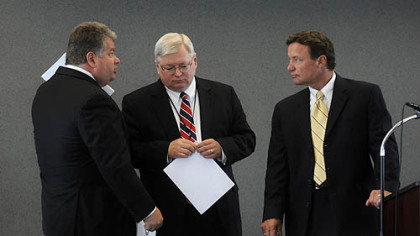Consultant John Verbanac, left, talks with Jim Hassinger and Charlie Camp before a meeting of the Southwestern Pennsylvania Commission.