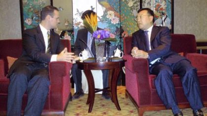 Mayor Luke Ravenstahl is greeted before a 10-course lunch by Tang Deng Jie, vice mayor of Shanghai, on Friday at the Grand Central Hotel in Shanghai. An interpreter is seated between and behind.