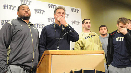 Surrounded and supported by his players, University of Pittsburgh football head coach Dave Wannstedt announces his resignation at the team's South Side facility. He will remain in the athletic department in a non-coaching capacity.