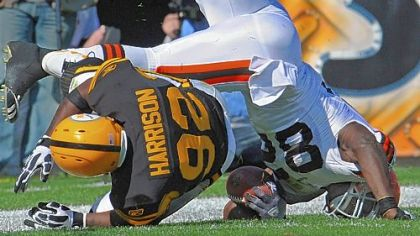 James Harrison upends the Browns' Benjamin Watson Sunday at Heinz Field.