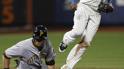 Mets shortstop Jose Reyes looks to first after forcing out the Pirates' Garrett Jones after Pedro Alvarez hit into a fourth-inning double play.