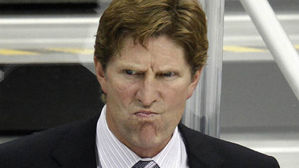 Red Wings coach Mike Babcock watches the first period.