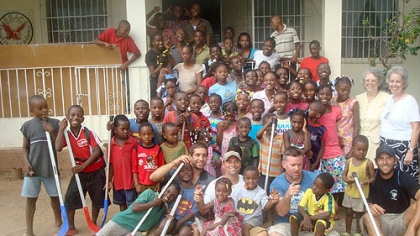 Orphans gather at porch of EBAC orphanage with (from left) Max Talbot, Brad Henderson, Sean Casey and Mike Rupp. At right are Alice Wise (left) and Kathy Gouker, missionaries from Dunbar, Fayette County, who have run the orphanage for 32 years.