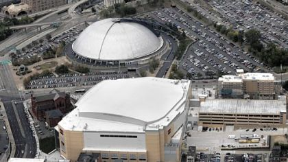 The Civic Arena, in back, and the new Consol Energy Center