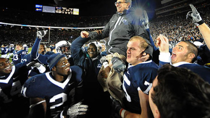 Penn State  head coach Joe Paterno gets carried off the field after getting his 400th career win against Northwestern at Beaver Stadium in University Park, Pa. Saturday.