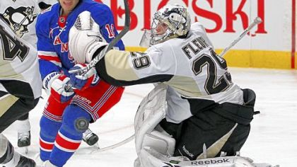 The Rangers&#039; Sean Avery skates past Marc-Andre Fleury as he chases the puck in the second period Monday in New York.