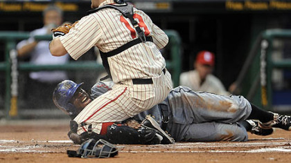 The Mets' Jose Reyes slides safely past Pirates catcher Chris Snyder in the first inning Saturday at PNC Park.