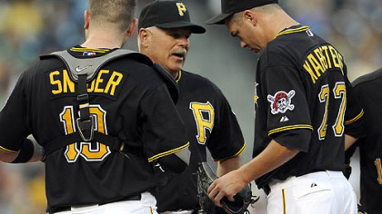 Pirates interim pitching coach Ray Searage talks to pitcher Jeff Karstens.