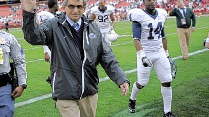 Penn State head coach Joe Paterno waves to the crowd as he leaves the field after beating Indiana 41-24 Saturday at Fedex Field in Landover, Md.