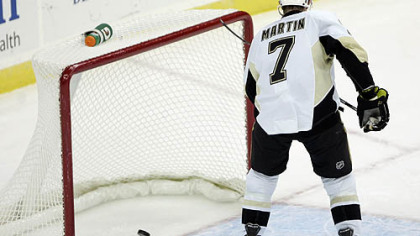 Penguins defenseman Paul Martin scores an empty-net goal during the the third period of Monday's game at the Prudential Center in Newark, N.J.