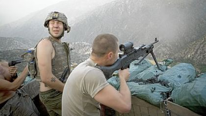 Specialist Misha Pemble-Belkin, left, and fellow soldiers from Battle Company, 173rd US Airborne during a firefight at Outpost Restrepo during combat in Afghanistan's Korengal Valley.