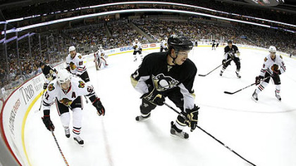 Penguins defenseman Simon Despres handles the puck in the corner.