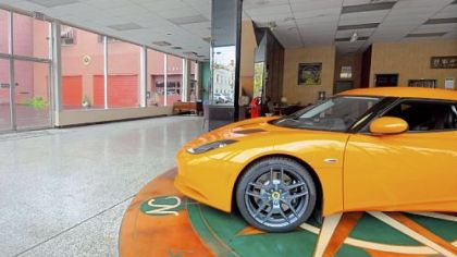 A Lotus Evora remains in the almost empty showroom at Ascot Imported Cars in Sewickley.