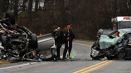 State police investigate the scene of an accident in Butler County in which four people were killed.