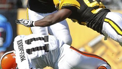 Linebacker James Harrison hits Browns wide receiver Mohamed Massaquoi. The NFL fined Harrison $75,000 for the hit.