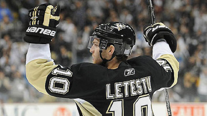 Penguins forward Mark Letestu celebrates his first period goal.