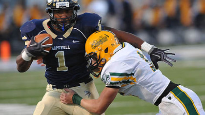 Hopewell's Rushel Shellis tackled by Blackhawk's Josh Desmond during Friday's game.