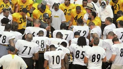 Mike Tomlin gathers the team around him at the end of practice Wednesday. It was the final day for two-a-day practices this week as the team prepares for Saturday night's preseason opener vs. Detroit at Heinz Field.