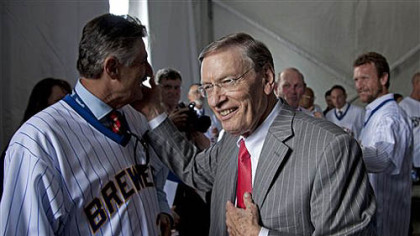 Major League Baseball commissioner Bud Selig talks to former players including Rollie Fingers, left, and Robin Yount, right, before a ceremony to unveil a statue of Selig outside Miller Park on  Tuesday, in Milwaukee. Selig is the former owner of the Milwaukee Brewers.