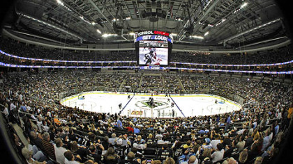 The puck is dropped to start the first NHL hockey game to be played in Consol Energy Center.