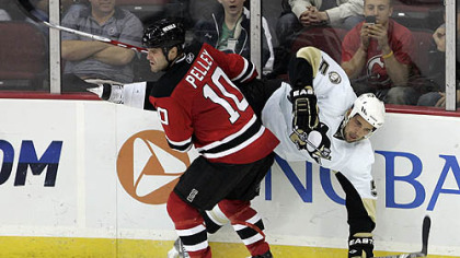 Devils forward Rod Pelley flips Penguins defenseman Deryk Engelland during the third period.