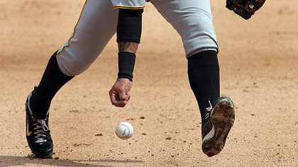 Pirates shortstop Ronny Cedeno loses control of a ball hit by Marlins&#039; Gaby Sanchez during the sixth inning.